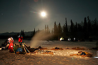 March 5, 2007   Finger Lake checkpoint---- Teams rest under the moonlight at the Finger Lake checkpoint on Monday morning.