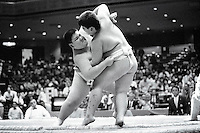 Two Rikishi fight for dominance during their contest...450 children, aged between 11-14, quilified for the  from ook part in the All Japan Wanpaku Sumo Tournament. The  Ryogoku Kokugikan Stadium, Tokyo, Japan.
