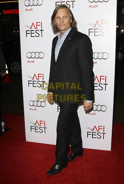 "VIGGO MORTENSEN.AFI FEST 2009 Screening Of ""The Road"" held At The Grauman's Chinese Theatre, Hollywood, California, USA..November 4th, 2009.full length black suit blue shirt white striped stripes .CAP/ADM/KB.©Kevan Brooks/AdMedia/Capital Pictures."
