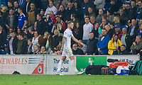 Liam Cooper of Leeds United looks dejected as he leaves the field after being sent off during the Sky Bet Championship match between Cardiff City and Leeds United at the Cardiff City Stadium, Cardiff, Wales on 26 September 2017. Photo by Mark  Hawkins / PRiME Media Images.
