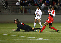 BOYDS, MARYLAND - April 06, 2013:  Jasmyne Spencer (20) of The Washington Spirit beats Churchill O'Connell (1) of the University of Virginia women's soccer team for the third goal in a NWSL (National Women's Soccer League) pre season exhibition game at Maryland Soccerplex in Boyds, Maryland on April 06. Virginia won 6-3.