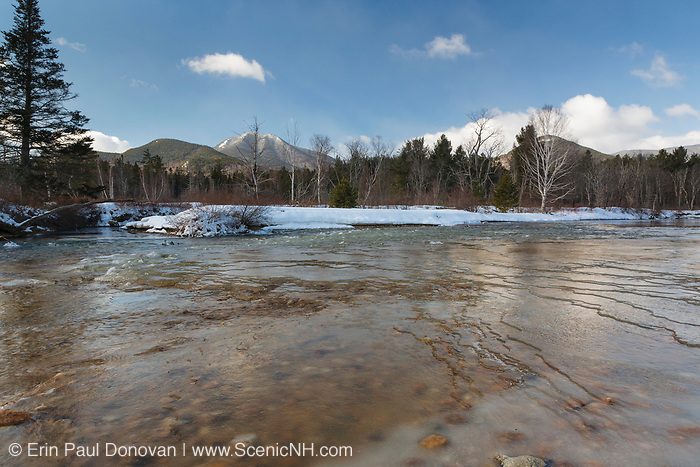 Swift River during the spring months. This river travels along side of the Kancamagus Highway (route 112) which is one of New England's scenic byways in the White Mountains, New Hampshire USA. This area was part of the Swift River Railroad, which was an logging railroad in operation from 1906 - 1916. Mount Passaconaway is off in the distance