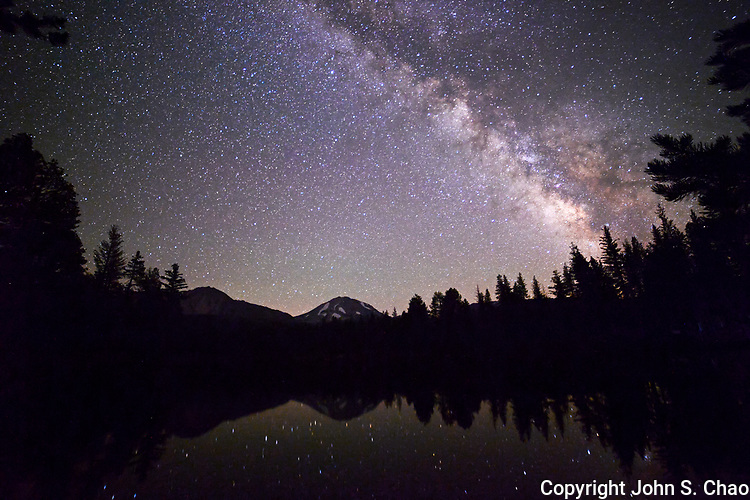 Milky Way over Lassen Peak with stars in Reflection Lake, Lassen Volcanic National Park, California