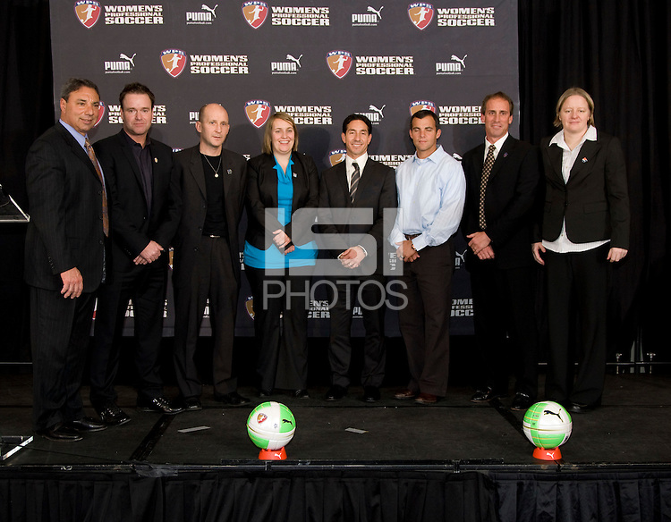 Head Coaches Tony  DiCicco, Gareth O'Sullivan, Paul Riley,  Emma Hayes, Albertin Montoya, GM Charlie Naimo, Jim Gabarra, and Pauliina Miettinen stand on the stage during the 2010 WPS draft at the Pennsylvania Convention Center in Philadelphia, PA.