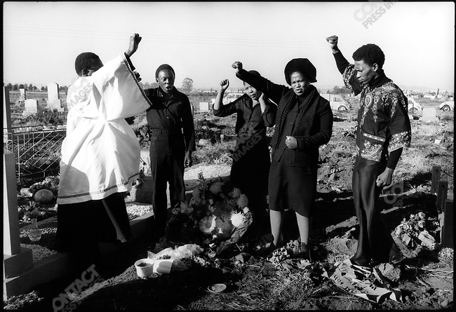 The family and two friends of Hector Peterson, the Soweto (June '76) Massacre's first victim, lay a wreath at his grave. No more than 5 people were allowed to gather as it would have constituted a riotous assembly. South Africa, June 1978.