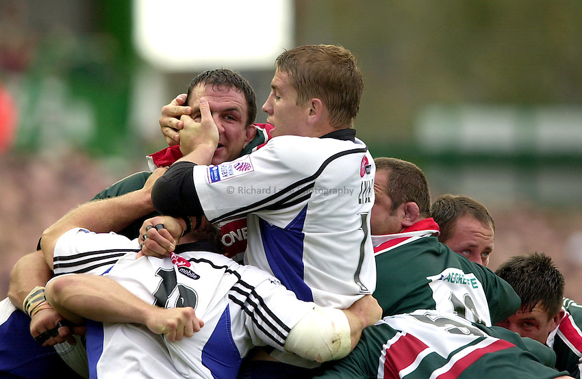 Photo. Richard Lane. .Leicester Tigers v Bath Rugby. Zurich Premiership. 05/10/2002.Dan Lyle gets to grips with Martin Johnson.