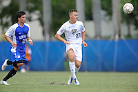 2 October 2011:  FIU forward Quentin Albrecht (22) passes the ball with Kentucky defender Charlie Pettys (21) in pursuit in the second half as the FIU Golden Panthers defeated the University of Kentucky Wildcats, 1-0 in overtime, at University Park Stadium in Miami, Florida.
