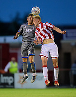 Lincoln City's Joe Morrell vies for possession with Stoke City's Lasse Sorensen<br /> <br /> Photographer Chris Vaughan/CameraSport<br /> <br /> Football Pre-Season Friendly - Lincoln City v Stoke City - Wednesday July 24th 2019 - Sincil Bank - Lincoln<br /> <br /> World Copyright © 2019 CameraSport. All rights reserved. 43 Linden Ave. Countesthorpe. Leicester. England. LE8 5PG - Tel: +44 (0) 116 277 4147 - admin@camerasport.com - www.camerasport.com