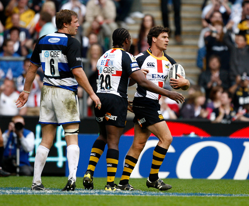 Photo: Richard Lane/Richard Lane Photography. London Wasps v Bath Rugby. The St. George's Day Game. Guinness Premiership. 24/04/2010. Wasps' Ben Jacobs celebrates his try with Serge Betsen.