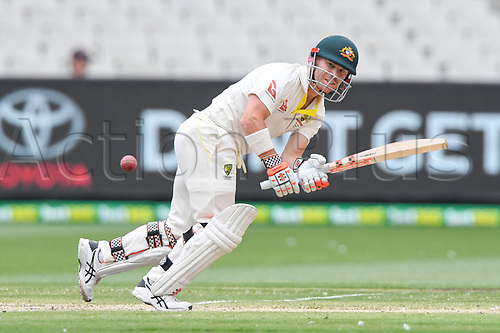 30th December 2017, Melbourne Cricket Ground, Melbourne, Australia; The Ashes Series, fourth test, day 5, Australia versus England; David Warner of Australia keeps a close eye on the ball after edging it down the leg side