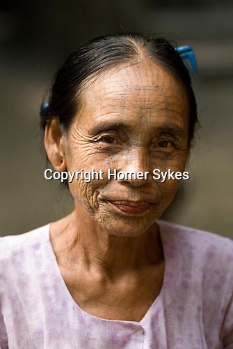 PANMYAUNG VILLAGE,  Myanmar (Burma) 2008.Chin tribal women with tattooed faces.