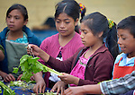 School children in Tuixcajchis, a small Mam-speaking Maya village in Comitancillo, Guatemala, learn about nutrition as they cook vegetables during class. The special program is sponsored by the Maya Mam Association for Investigation and Development (AMMID).