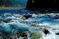 Fisherman rafting the Middle Fork of the Flathead River, Montana.
