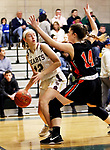 WATERBURY CT. 16 February 2018-021619SV25-#12 Hayley Tucker of Sacred Heart High looks to pass as #14 Alyssa Santangeli of Watertown High defends during the NVL girl&rsquo;s basketball tournament in Waterbury Saturday.<br /> Steven Valenti Republican-American