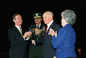 United States Secretary of Defense William S. Cohen (left) applauds U.S. Senator John H. Glenn, Jr (Democrat of Ohio) (second from right) after presenting him the Department of Defense Medal for Distinguished Public Service at an armed forces review and award ceremony at Fort Myer, Virginia, on December 4, 1998.  Joining in the celebration are Chairman of the Joint Chiefs of Staff General Henry H. Shelton, (second from left) and Mrs. Annie Glenn (right).  Cohen presented the medal to Glenn for his distinguished service to the nation. .Mandatory Credit: Helene C. Stikkel / DoD via CNP