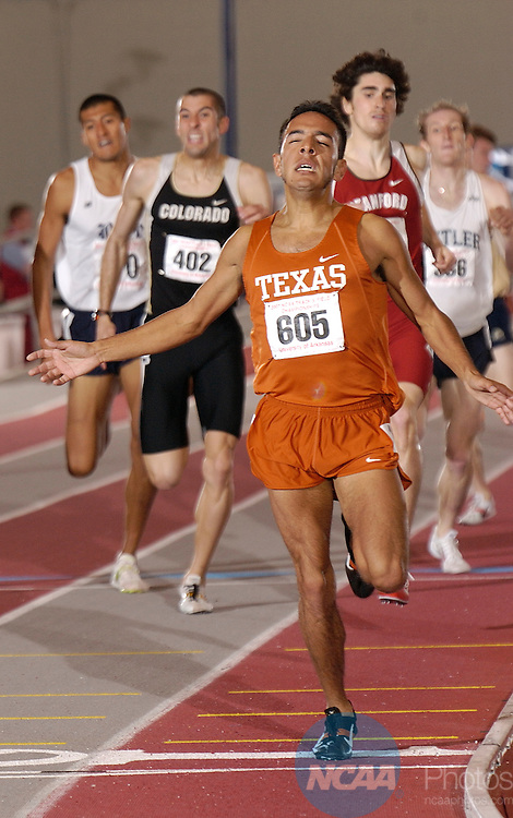 10 MAR 2007: Leonel Manzano of theUniversity of Texas wins the 1 mile run  during the Division I Indoor Track and Field Championships held at the Randal Tyson Track Complex on the University of Arkansas campus in Fayetteville, Ark. Leonel finished with a 3:59:90  time. Phillip Walrod/NCAA Photos..