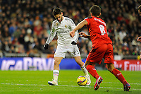 Real Madrid´s Isco and Sevilla's Cristoforo during 2014-15 La Liga match between Real Madrid and Sevilla at Santiago Bernabeu stadium in Alcorcon, Madrid, Spain. February 04, 2015. (ALTERPHOTOS/Luis Fernandez) /NORTEphoto.com