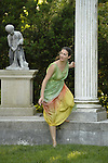 Old Westbury, New York, U.S. - June 21, 2014 - When Lori Belilove & The Isadora Duncan Dance Company starts to dance throughout the gardens, a dancer appears at the Colonnade, as visitors follow the performances, at the Long Island Gold Coast estate of Old Westbury Gardens on the first day of summer, the summer solstice.