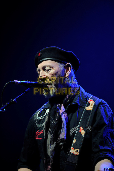 Richard Thompson.performing in concert, Shepherd's Bush Empire, London, England. .25th February 2013.on stage lie gig performance music length hat flat cap scarf black shirt half singing profile goatee facial hair .CAP/MAR.© Martin Harris/Capital Pictures.