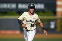 Christian Long (19) of the Wake Forest Demon Deacons hustles towards third base against the Virginia Cavaliers at David F. Couch Ballpark on May 19, 2018 in  Winston-Salem, North Carolina. The Demon Deacons defeated the Cavaliers 18-12. (Brian Westerholt/Four Seam Images)