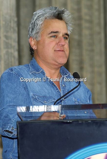 "Jay Leno presenting the  2270th star "" Tim Allen ""on the Hollywood Walk of Fame in Los Angeles. November 19, 2004."