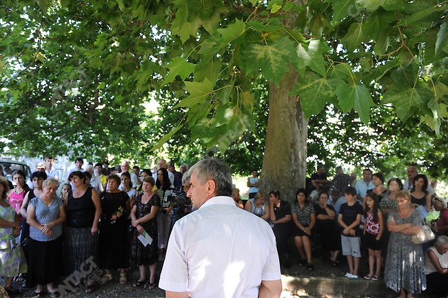 Raul Khadzhibma, one of the presidential candidates in the upcoming presidential elections in Abkhazia, waited to speak at a meeting with voters in Nizhny Ishera held under an enormous plane tree. Abkhazia, August 23, 2011