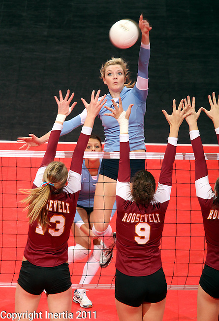 SIOUX FALLS, SD - NOVEMBER 19:  Erin Radke #3 from Lincoln soars above the defese for a kill against Tagyn Larson #13 and Heather Beaner #9 from Roosevelt during the 2011 South Dakota State Volleyball Championships Saturday night at the Arena. (Photo by Dave Eggen/Inertia)