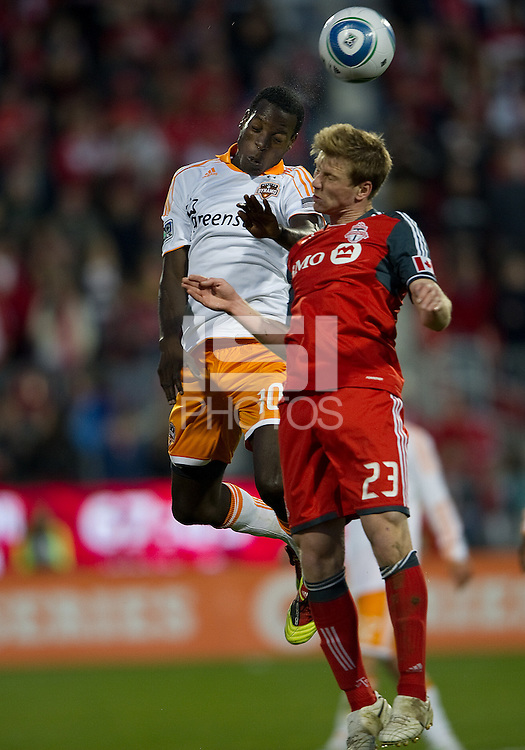 07 May2011: Houston Dynamo midfielder Je-Vaughan Watson #10 and Toronto FC midfielder Jacob Peterson #23 in action during an MLS game between the Houston Dynamo and the Toronto FC at BMO Field in Toronto, Ontario..Toronto FC won 2-1.