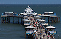 31/05/15<br /> <br /> On the last day of the half-term, Whitsun break, holiday-makers enjoy a brief moment of sunshine on Llandudno pier, North Wales.<br /> <br /> All Rights Reserved - F Stop Press.  www.fstoppress.com. Tel: +44 (0)1335 418629 +44(0)7765 242650