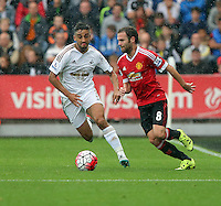 Pictured L-R: Neil Taylor of Swansea against Juan Mata of Manchester United Sunday 30 August 2015<br /> Re: Premier League, Swansea v Manchester United at the Liberty Stadium, Swansea, UK