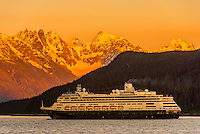 Holland America Line cruise ship MS Zaandam sailing out of Haines, Alaska USA at sunset toward Skagway on the Lynn Canal (the deepest fjord in North America).