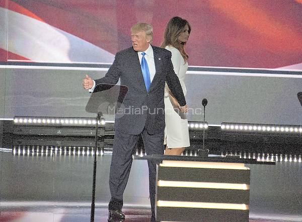 Donald and Melania Trump leave the podium following her remarks at the 2016 Republican National Convention at the Quicken Loans Arena in Cleveland, Ohio on Monday, July 18, 2016.<br /> Credit: Ron Sachs / CNP/MediaPunch<br /> (RESTRICTION: NO New York or New Jersey Newspapers or newspapers within a 75 mile radius of New York City)