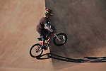 Boy riding his bike in a skateboard park in Denver, Colorado.