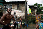 People wash clothes, bathe and fetch buckets of water from the runoff of a sawmill, in the impoverished neighborhood of Mabella, Freetown, Sierra Leone, Aug. 15, 2012. Many people live without running water, toilets, or basic sanitation services, conditions that make illnesses such as cholera more prevalent. Médecins Sans Frontières Belgium, in collaboration with the Sierra Leone Ministry of Health, is running four emergency cholera treatment centers to keep up with the number of patients. Many of the roughly 120 daily patients seen by the MSF team come from extremely impoverished areas of the densely-populated capital, where proper systems for drainage and waste disposal are almost non-existent. Outbreaks of water-borne diseases like cholera become even more likely during the rainy season, which is expected to last at least two more months.
