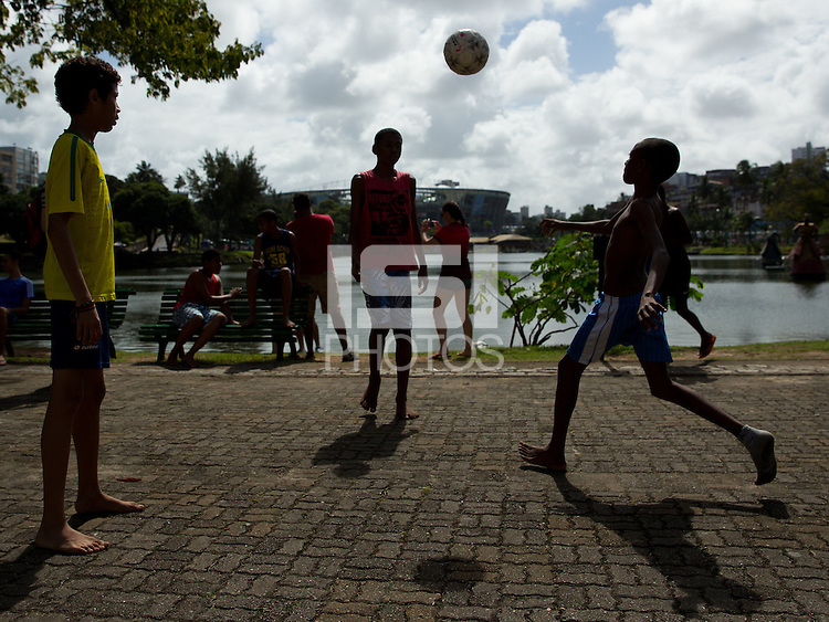 Kids play football near Arena Fonte Nova