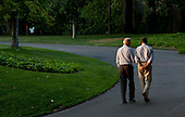 "July 24, 2011.""During a break in the debt limit and deficit negotiations with Congress, the President walks around the South Lawn drive of the White House with the Vice President on a Sunday in July. As they walked, I was trying to catch them where there was one pocket of sunlight seeping through the trees."" .Mandatory Credit: Pete Souza - White House via CNP"
