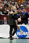 CLEVELAND, OH - MARCH 16: Seth Gross, of South Dakota State, jumps into his coaches arms after winning his match in the 133 weight class during the Division I Men's Wrestling Championship held at Quicken Loans Arena on March 16, 2018 in Cleveland, Ohio. (Photo by Jay LaPrete/NCAA Photos via Getty Images)