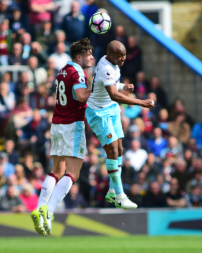 Burnley's Kevin Long vies for possession with West Ham United's Andre Ayew<br /> <br /> Photographer Andrew Vaughan/CameraSport<br /> <br /> The Premier League - Burnley v West Ham United - Sunday 21st May 2017 - Turf Moor - Burnley<br /> <br /> World Copyright &copy; 2017 CameraSport. All rights reserved. 43 Linden Ave. Countesthorpe. Leicester. England. LE8 5PG - Tel: +44 (0) 116 277 4147 - admin@camerasport.com - www.camerasport.com