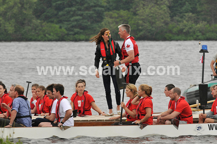 **ALL ROUND PICTURES FROM SOLARPIX.COM**                                             **WORLDWIDE SYNDICATION RIGHTS**                                                                                  Caption: Prince William and Princess Catherine, aka Kate Middleton, The Duke and Duchess of Cambridge, at the P.E.I dragon boat race , Prince Edward Island, during their Royal Tour of Canada. 4 July 2011                                                                              This pic: Prince William and Princess Catherine                                                                                             JOB REF: 13672 MSR       DATE:  04_07_2011                                                          **MUST CREDIT SOLARPIX.COM OR DOUBLE FEE WILL BE CHARGED**                                                                      **MUST AGREE FEE BEFORE ONLINE USAGE**                               **CALL US ON: +34 952 811 768 or LOW RATE FROM UK 0844 617 7637**