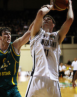 Boomers centre AJ Ogilvy fouls Alex Pledger during the International basketball match between the NZ Tall Blacks and Australian Boomers at TSB Bank Arena, Wellington, New Zealand on 25 August 2009. Photo: Dave Lintott / lintottphoto.co.nz