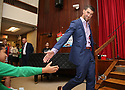 Colgate global ambassador Michael Phelps right, gives a high five to a student at the Celebration of Campus Sustainability Month at Alain L. Locke Magnet School on Thursday, Oct. 19, 2017 in New York. (Photo by Donald Traill/Invision for Colgate/AP Images)