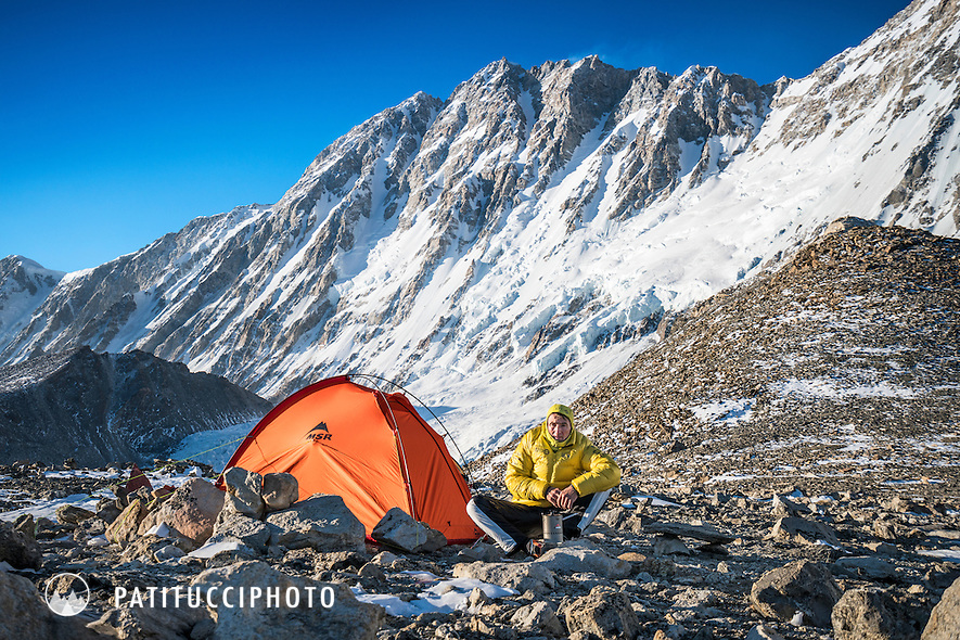 Ueli Steck using a camp stove at advance basecamp during his climbing expedition to the 8000 meter peak Shishapangma, Tibet