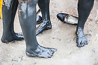 Bathers' feet covered in mud following a dip in the Dead Sea, the waters of which are renowned for its health benefits.