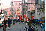 Chinese red flag and people in busy Canton street. Pictures taken in Canton China in 1977 at the time of the cultural revolution.