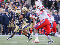 Annapolis, MD - November 11, 2017: Navy Midshipmen running back Malcolm Perry (10) runs the ball during the game between SMU and Navy at  Navy-Marine Corps Memorial Stadium in Annapolis, MD.   (Photo by Elliott Brown/Media Images International)