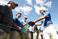 Gary Woodland signs autographs before going to the 6th tee at the 5th Annual Notah Begay III Foundation Challenge at Atunyote Golf Club in Vernon, New York on August 29, 2012