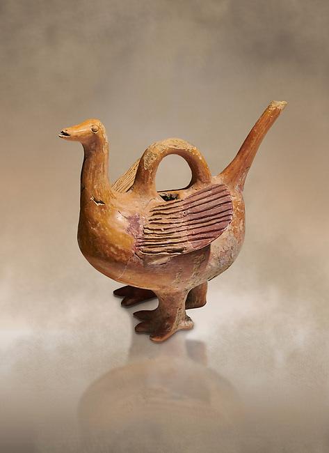 Bronze Age Anatolian terra cotta duck shaped ritual vessel - 19th to 17th century BC - Kültepe Kanesh - Museum of Anatolian Civilisations, Ankara, Turkey.  Against a warn art background.