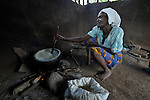 "Stella Sadya cooks porridge in a care center for orphans and other vulnerable children in Chidyamanga, a village in southern Malawi that has been hard hit by drought in recent years, leading to chronic food insecurity, especially during the ""hunger season,"" when farmers are waiting for the harvest. The ACT Alliance is working with farmers in this village to switch to alternative, drought-resistant crops, as well as using irrigation and other improved techniques to increase agricultural yields. In Chidyamanga, residents have set aside a section of farmland where they work together to grow food especially for the orphans--many of whom lost their parents to AIDS--and other children in the center. Three times a week, the children come to the center, sing and play and eat a nutritious meal."