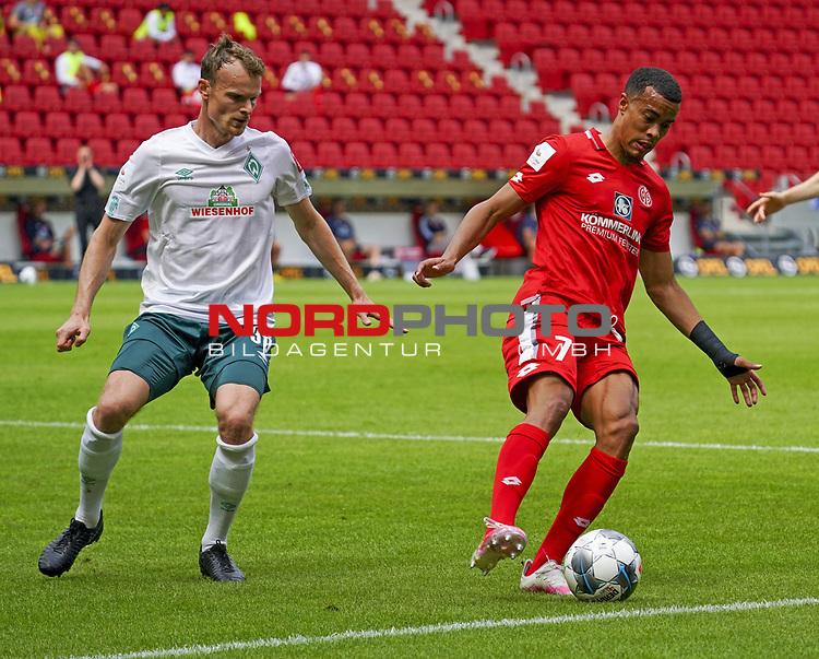 Sport: Fussball: 1. Bundesliga:: nphgm001:  Saison 19/20: 33. Spieltag: 1. FSV Mainz 05 vs SV Werder Bremen 20.06.2020<br />Robin Quaison (M05), Christian Gross Gro§ (Bremen),<br />Foto: Bratic/rscp-photovia/via gumzmedia/nordphoto<br /><br />DFL regulations prohibit any use of photographs as image sequences and/or quasi-video.<br />EDITORIAL USE ONLY.<br />National and international News-Agencies OUT.<br /><br /> DFL REGULATIONS PROHIBIT ANY USE OF PHOTOGRAPHS AS IMAGE SEQUENCES AND OR QUASI VIDEO<br />EDITORIAL USE ONLY<br />NATIONAL AND INTERNATIONAL NEWS AGENCIES OUT