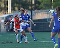 Allston, Massachusetts - May 22, 2015: First half action. In a National Women's Soccer League (NWSL) match, Boston Breakers (blue) vs Sky Blue FC (white/orange), 0-1 (halftime), at Soldiers Field Soccer Stadium.